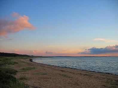 Het strand bij Trend tijdens ondergaande zon, zicht naar het zuiden © copyright dutchmarco